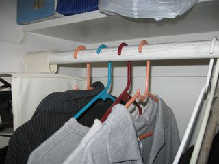Inverted Clothes Hanging in a Closet for a Red Tag Event at Lean for Everyone